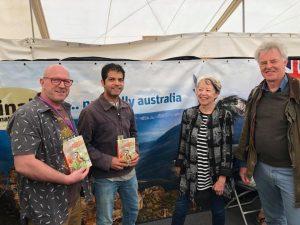 Peter Rowland and Aniket Sardana (founders of Australia's Wildlife Group) with John Beaufoy and Rosemary Wilkinson of John Beaufoy Publishing promoting the book at the Australia stand at the UK Birdfair at Oakham