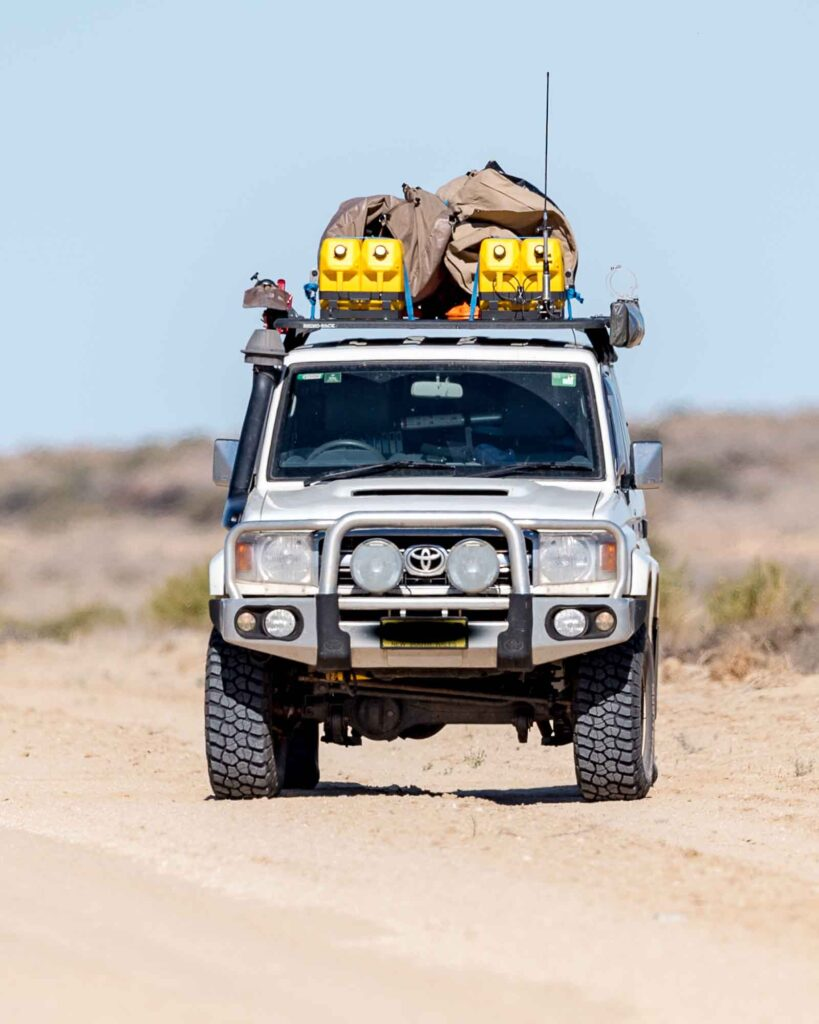 A 4WD on a dirt track in remote Australia